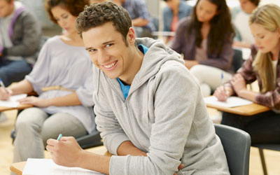 College student seated at desk in class