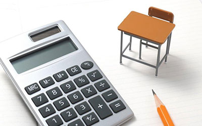 A pencil, desk and calculator